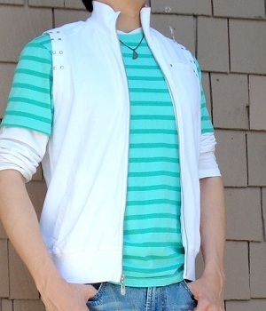 Green T-Shirt Between White T-Shirt And White Fashion Vest