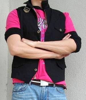 Pink t-shirt, black vest, light blue jeans