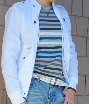 White jacket and a gray blue striped t-shirt
