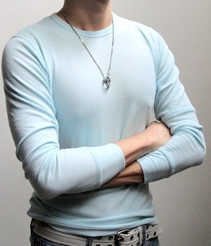 Wearing a light blue long sleeve T-shirt and a pendant