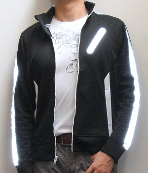 Black track jacket paired with a White graphic tee