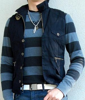 A black striped sweater under a black vest