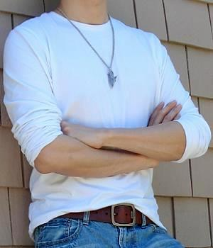 An example of wearing a solid white T-shirt and a silver pendant