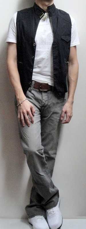 Black Vest White Graphic Tee Brown Belt Gray Jeans White Shoes