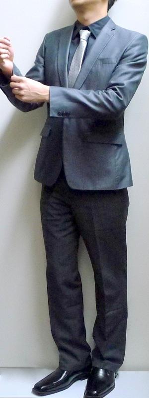 Men's Dark Gray Blazer Black Shirt Light Gray Striped Necktie Gray Pants Black Loafers