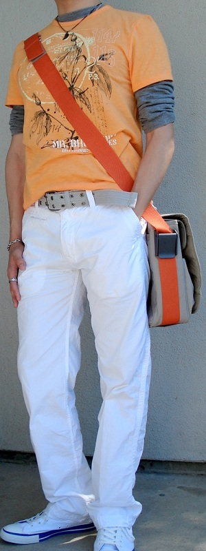 Orange Graphic Tee Beige Messenger Bag White Pants White Shoes