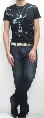 Black Graphic Tee Gold Webbing Belt Dark Blue Jeans Black Sneakers