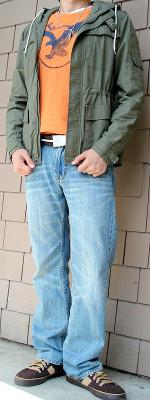 Dark Green Jacket Orange Graphic Tee Brown Belt Light Blue Jeans
