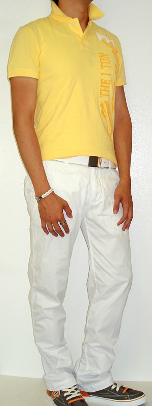 Yellow Graphic Tee White Belt White Pants Gray Shoes